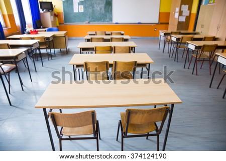 Empty class room of elementary school - stock photo