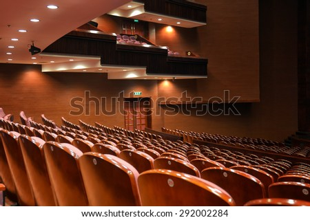 Empty classical theater with wooden chairs    - stock photo