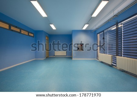 Empty classroom, blue. - stock photo