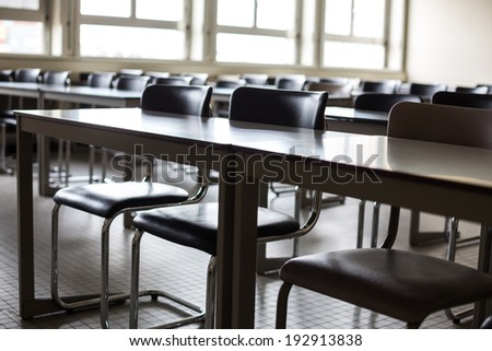 Empty classroom with chairs and desks - stock photo