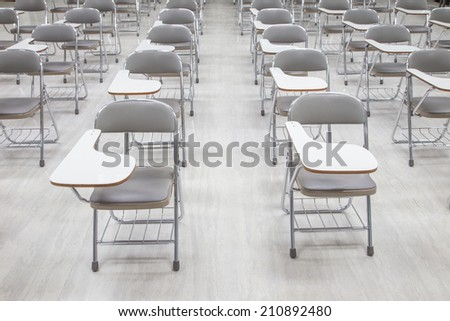 empty classroom with many armchairs.