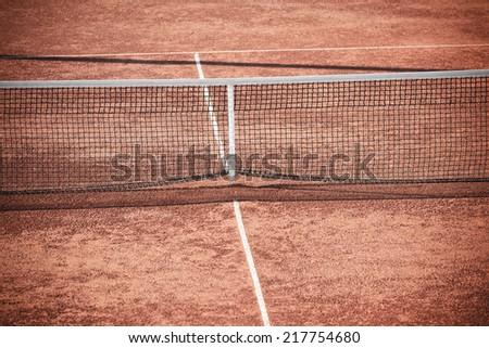 Empty Clay Tennis Court and Net. Horizontal shot - stock photo