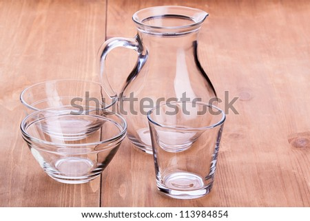 Empty clean glassware on a wooden table - stock photo
