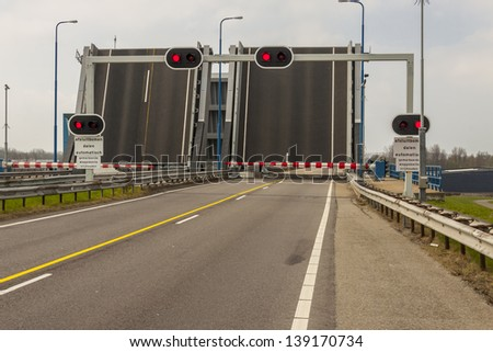 Empty close route 57 red light, open drawbridge - Netherlands. - stock photo