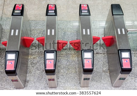 Empty closed turnstiles in the metro station, view from above. Entrance to subway. - stock photo