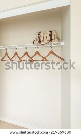Empty closet, working closet, cupboard in bedroom. - stock photo