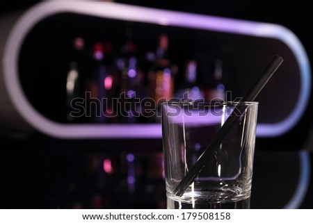 Empty cocktail glass on a bar symbol for don't drink and drive - stock photo