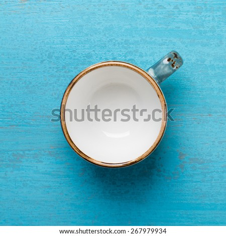 Empty coffee cup on blue wooden background. Square image - stock photo
