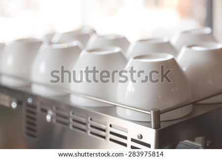 Empty coffee cup on coffee machine