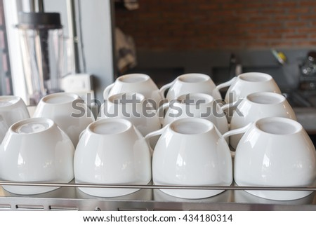 Empty coffee cup on coffee machine - stock photo