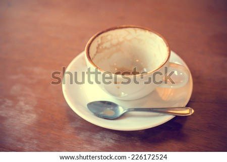 Empty coffee cup on the table in cafe - stock photo