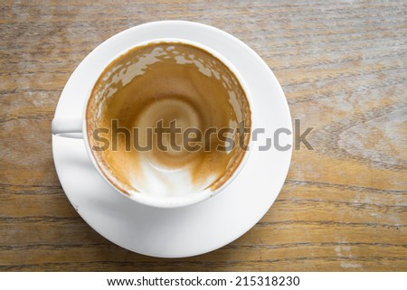 Empty coffee cup on wood table at coffee shop - stock photo