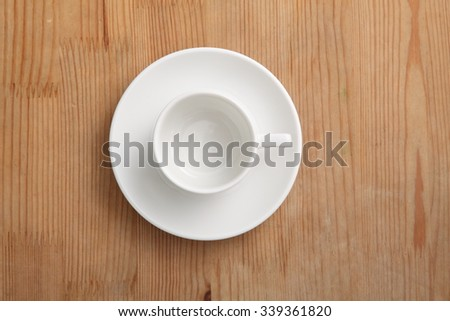 empty coffee cup or tea cup on the wooden table - stock photo