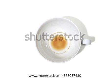 Empty Coffee Cup with Coffee Stain Inside on a White Background - stock photo