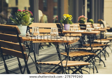 Empty coffee terrace with tables and chairs in marylebone london - stock photo
