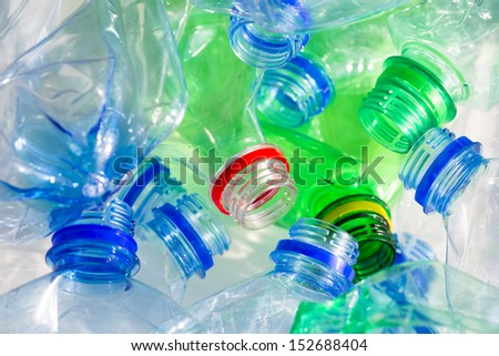 Empty colorful plastic bottles are recyclable waste - stock photo