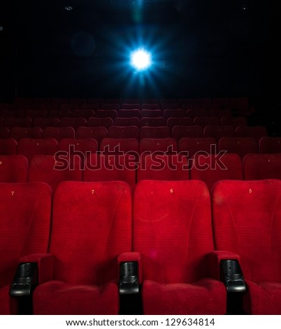 Empty comfortable red seats with numbers in cinema - stock photo