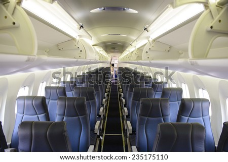 Empty commercial passenger aircraft cabin - stock photo