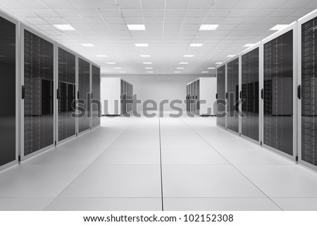 Empty Computer Center with neon lights and reflective floor - stock photo