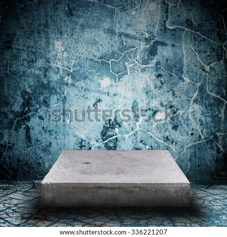 Empty concrete desk on grunge concrete room background with space for text or image