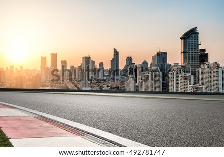 empty concrete road with modern skyline and buildings