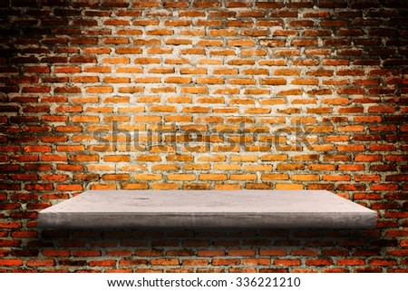 Empty concrete shelves on grunge brick wall background with space for text or image