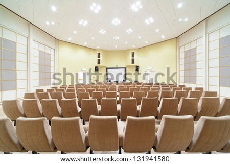 empty conference hall, design in white, yellow and beige - stock photo