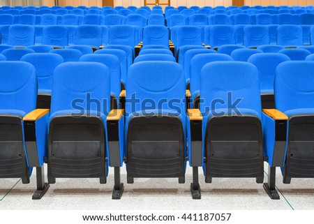Empty conference hall with blue armchairs