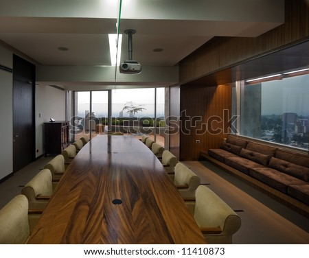 Empty conference room in a modern office environment.