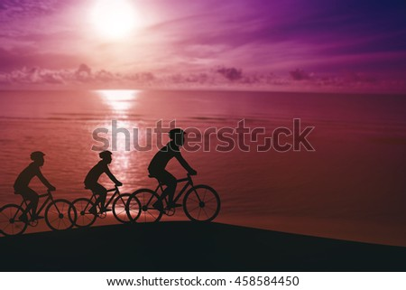 Empty Copy Space Sporty company friends on bicycles outdoors against sunset Silhouette five 3 cyclist going along shoreline coast Reflection sun on water Sport in Nature background Group of people - stock photo