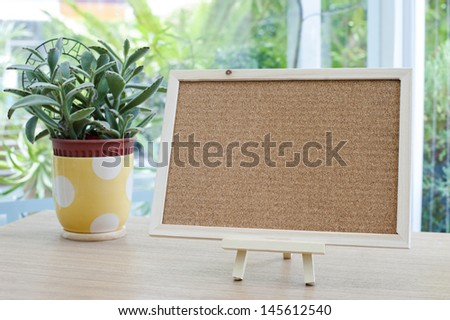 Empty cork board on the table - stock photo