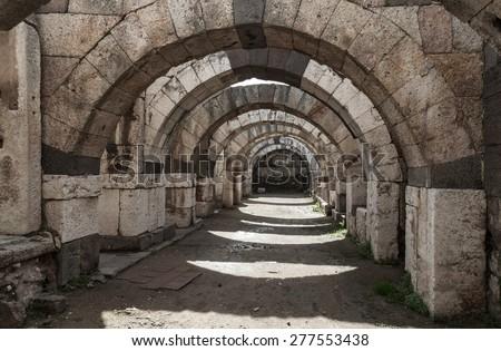 Empty corridor with arcs and columns. Ruins of Ancient city Smyrna. Izmir, Turkey - stock photo