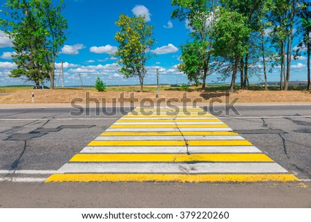 empty Country highway with a pedestrian crossing - stock photo