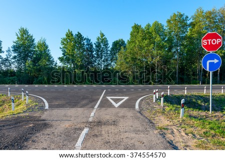 empty country road and crossroad a group signs - stock photo