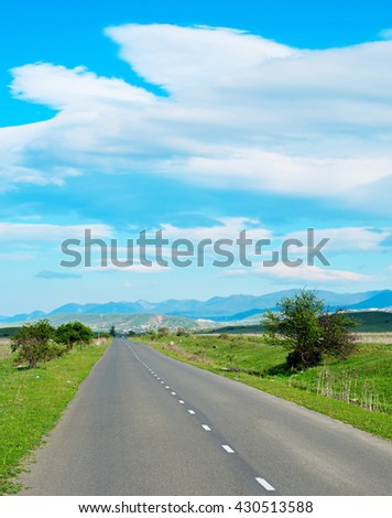 Empty Country road in Georgia in the bright sunny day. - stock photo