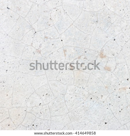 empty cracked stone wall background. - stock photo