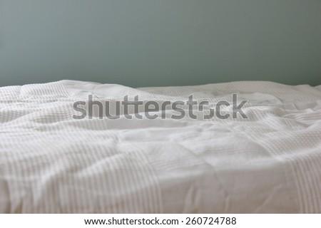 Empty crumpled bed - stock photo
