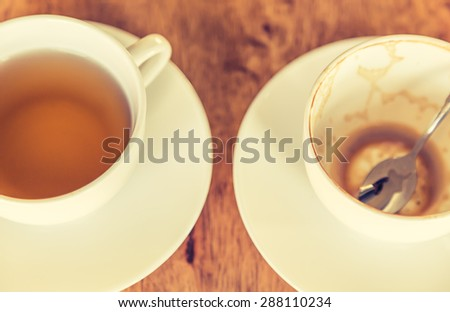 Empty cup of coffee on wooden table ( Filtered image processed vintage effect. ) - stock photo