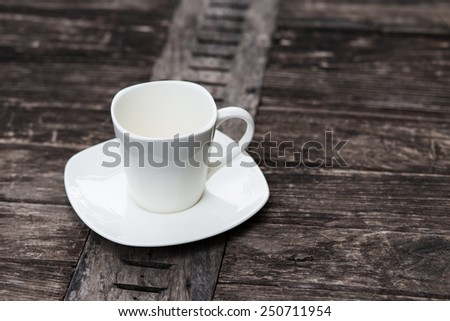 Empty cup on wood background - stock photo