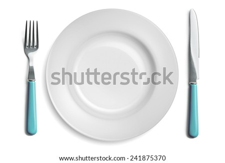 Empty cutlery set with a fork, knife and dinner plate, isolated on a white background. - stock photo