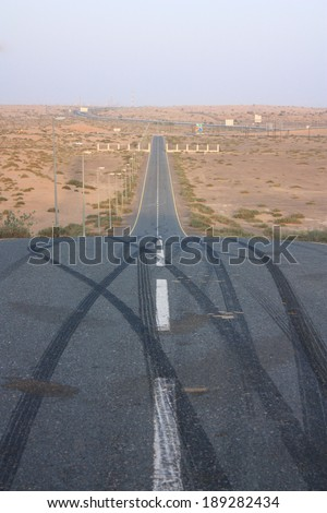 Empty desert downhill road - stock photo