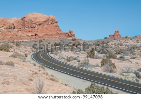 Empty desert road curve in the beautiful landscape of Utah
