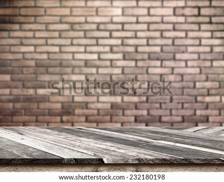 Empty Diagonal Wooden Table top at blurred red brick wall,Template mock up for display of your product,Business presentation - stock photo
