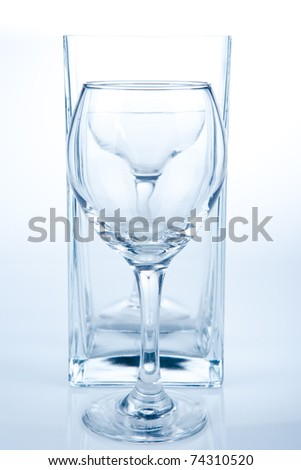 Empty different glasses on white - stock photo