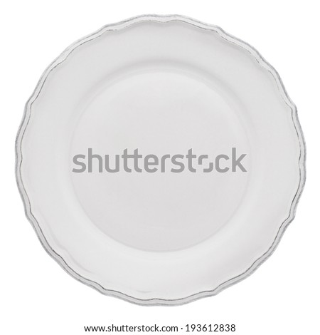 Empty dinner plate from above isolated on white. - stock photo