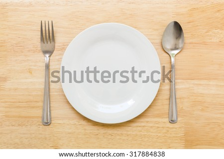 Empty Dish on Table Background