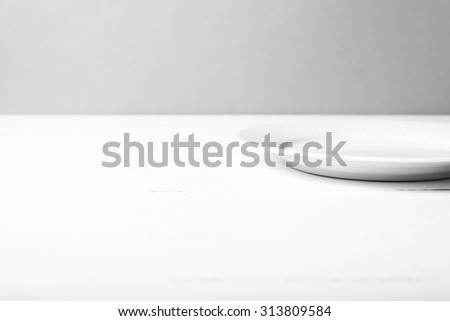 empty dish over white table background black and white tone color style