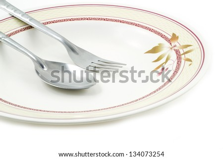 Empty dish spoon and fork on white background - stock photo