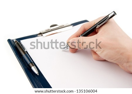 Empty document in a clipboard with a Hand holding felt tip pen isolated on white background
