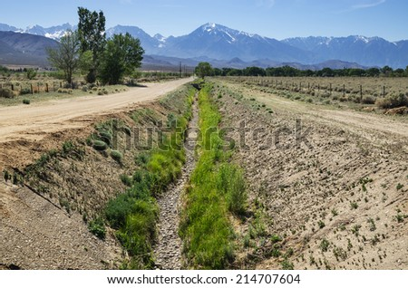 empty dry irrigation channel in the Owens Valley near Bishop - stock photo